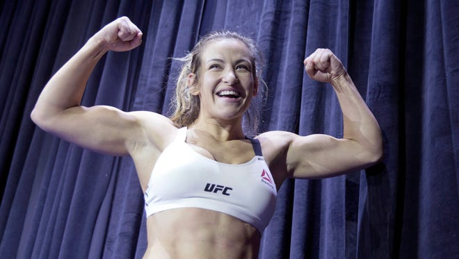 Miesha Tate flexes during pen workouts for UFC 196 on March 2, 2016, at MGM Grand in Las Vegas.
