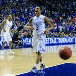 Kentucky's Tyler Ulis celebrates after teammate Aaron Harrison hit a big three in the second half to spark the Wildcats past Florida in Friday's SEC Tournament in Nashville. Aaron Harrison finished with 13 points and three rebounds with one block. Ulis finished with seven points. By Matt Stone, The Courier-Journal March 13, 2015