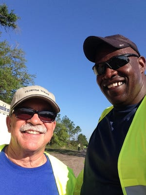 You spend two hours walking, talking and sweating your way along a sandy trail, you've got to have a selfie. That's me with Brevard County Commissioner Robin Fisher.