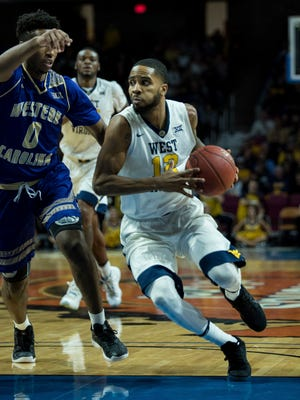 West Virginia's Tarik Phillip (12) drives to the basket during the second half of an NCAA college basketball game against Western Carolina on Wednesday in Charleston, W.Va. West Virginia won 90-37.