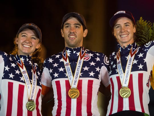 From left, Emma White, Ty Magnar and Leigh Ann Ganzar pose for a photo after the 2018 USA Cycling Pro Criterium National Championships in downtown Knoxville on Friday.