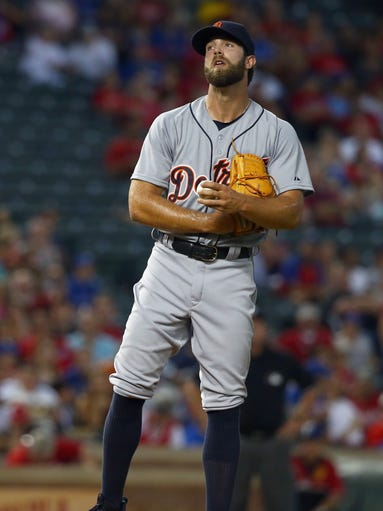 Detroit Tigers'  Daniel Norris  reacts after giving