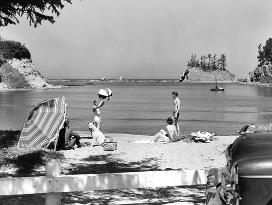 Beachgoers recreating at Sunset Bay on the southern