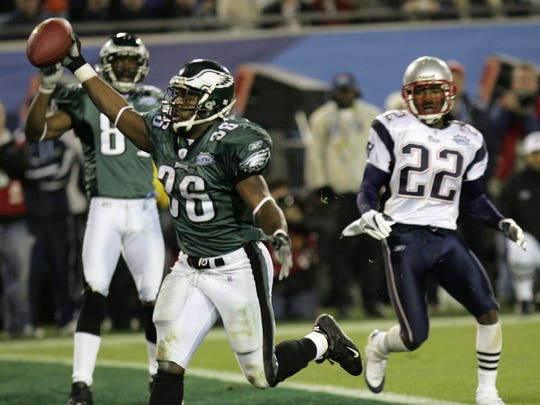 2005: Philadelphia Eagles running back Brian Westbrook celebrates his 10-yard touchdown reception in the third quarter against the New England Patriots during Super Bowl XXXIX at Alltel Stadium on Sunday, Feb. 6, 2005, in Jacksonville, Fla. Watching at right is the Patriots' Asante Samuel (22). The teams face off again - this time in Minnesota - at Sunday's Super Bowl.