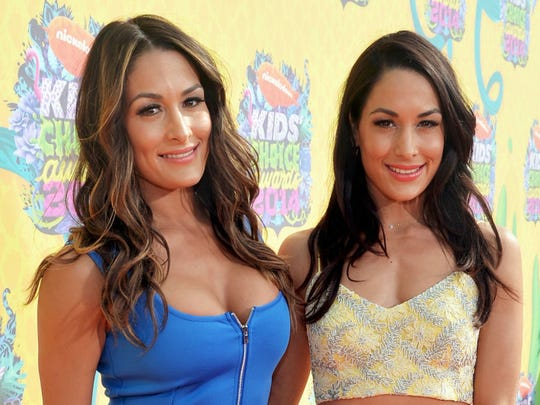 Nikki Bella (left) and Brie Bella will greet fans at