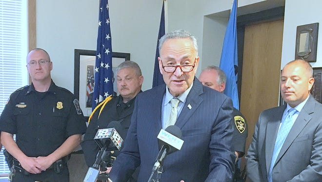 U.S. Sen. Charles Schumer, joined by local law enforcement officials, announces new legislation to combat synthetic drugs during a news conference Friday in Schuyler County.