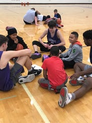 Lakeview varsity basketball players talk to Minges
