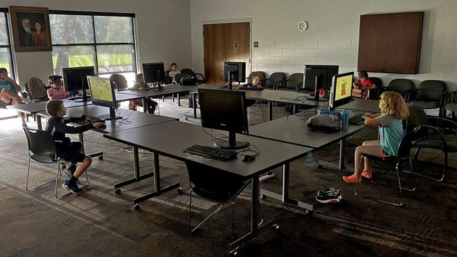 Children enjoy computer time while remaining socially distanced at the Dover Foundation YMCA.