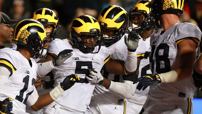 Jabrill Peppers of the Michigan Wolverines celebrates with teammates after scoring a touchdown in the first half against Rutgers.