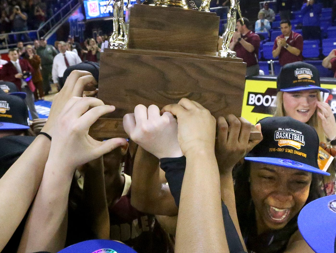 Riverdale's Anastasia Hayes (3) holds up the Championship Trophy with her teammates as they celebrate their victory over Memphis Central in the Class AAA State Tournament on Saturday, March 11, 2017.