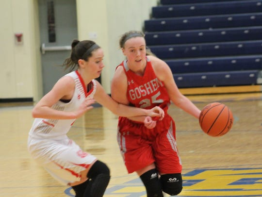 Goshen's Paige Garr drives left against Reagan Leonard