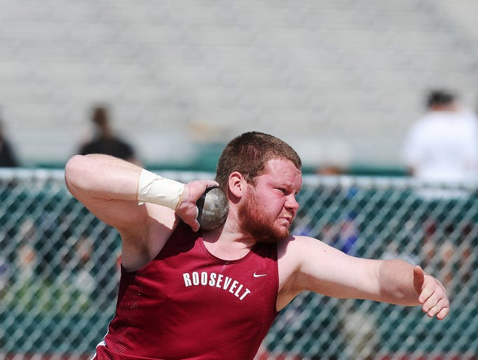 Roosevelt's Jack Lembcke competes in the boys shot put event during the Metro Conference Track meet on Friday, May 9, 2014, at Howard Wood Field in Sioux Falls.