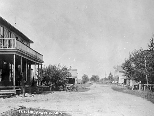 The first Parnell Tavern, seen at left, burned to the