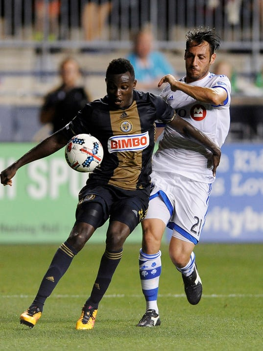 Philadelphia Union's Joshua Yaro, left, and Montreal Impact's Matteo Mancosu vie for the ball during the first half of an MLS soccer match Saturday, Aug. 12, 2017, in Chester, Pa. The Impact won 3-0. (AP Photo/Michael Perez)