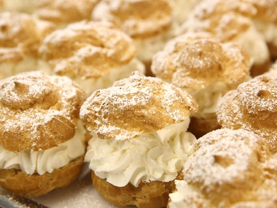Finished cream puffs are ready to be boxed at The Original Cream Puff Pavilion at the Wisconsin State Fair in West Allis.