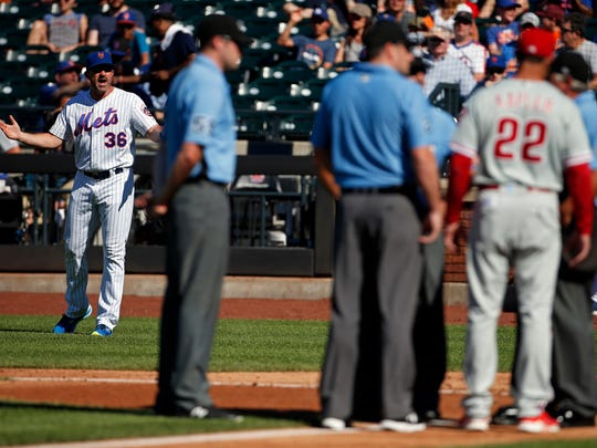 New York Mets manager Mickey Callaway (36) yells towards the umpires and Philadelphia Phillies manager Gabe Kapler (22) during the second inning at Citi Field.
