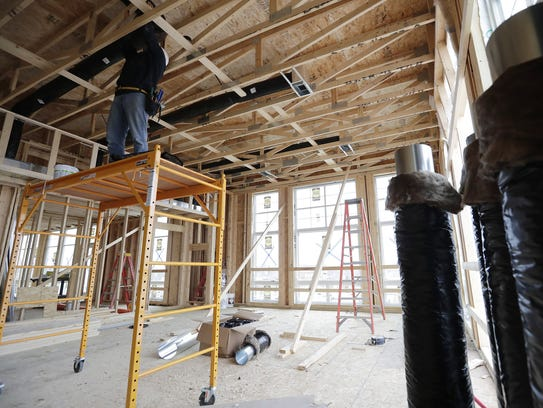 Construction continues in a three-bedroom apartment