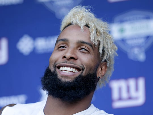 New York Giants' Odell Beckham, Jr. talks to reporters after NFL football practice in East Rutherford, N.J., Tuesday, June 13, 2017. (AP Photo/Seth Wenig)