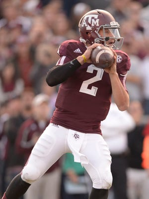Johnny Manziel did not repeat as the Heisman winner, but he did put up better numbers this year than last.