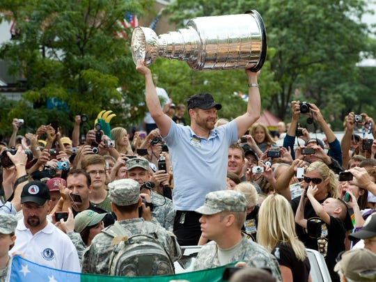 Boston Bruins goalie and former Vermont Catamount Tim Thomas parades the Stanley Cup up the Church Street Marketplace for an enthusiastic crowd on Saturday, Sept. 3, 2011, in Burlington, Vt. Thomas also made a few comments, thanking the National Guard and communities for helping the state work to recover from flooding caused by Tropical Storm Irene. He helped lead the Bruins to their first Stanley Cup since 1972 and won the Conn Smythe Trophy.