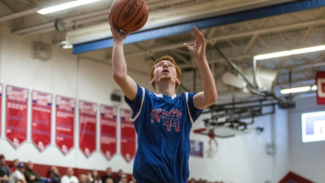 St. Clair's Matt Eisenhardt takes a shot during the Pink Halo Project charity basketball game, Jan. 28, 2017 at St. Clair High School.