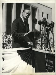 Col. Charles A. Lindbergh is shown speaking to a crowd