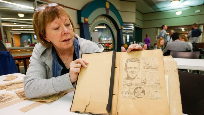 """Luci March brought in a binder of clippings from when her father was a track star during the Springfield News-Leader's """"More to the Story"""" event at the Library Center on Saturday, Nov. 4, 2017."""