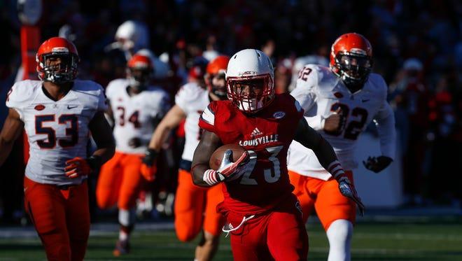 Louisville's Brandon Radcliff breaks past a horde of UVA defenders for a long touchdown run.  Nov. 14, 2015