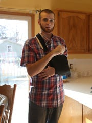 Zach Whitehill talks about the recovery ahead after being shot randomly recently in Pleasant Hill, seen here inside his home on Wednesday, Dec. 3, 2014, in Pleasant Hill, Iowa. Zach Whitehill was one of two victims of a random shooting in Pleasant Hill recently.