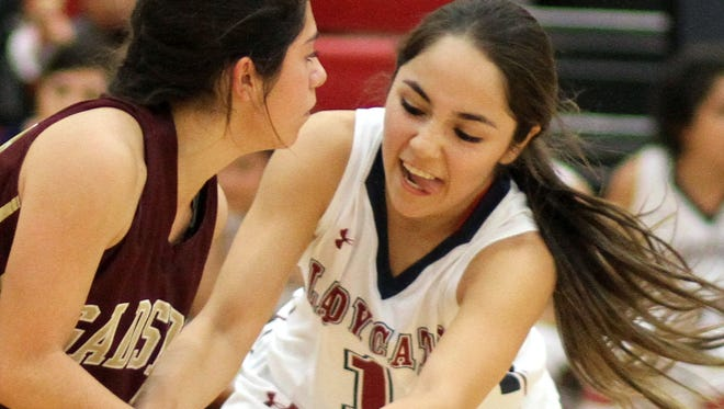 Senior point guard Valerie Lopez, right, will lead the Lady Cats against Centennial High on Tuesday, Nov. 29 at Frank Dooley Court on the campus of Deming High School. Tip off is at 7 p.m.