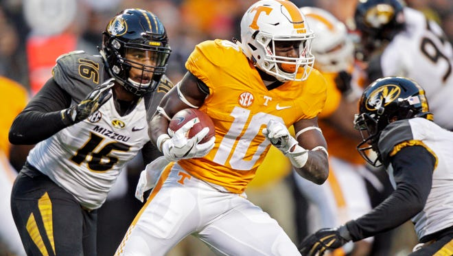 Tennessee wide receiver Tyler Byrd (10) runs for yardage as he's chased by Missouri safety Brock Bondurant (16) during the first half of an NCAA college football game Saturday, Nov. 19, 2016, in Knoxville, Tenn. (AP Photo/Wade Payne)