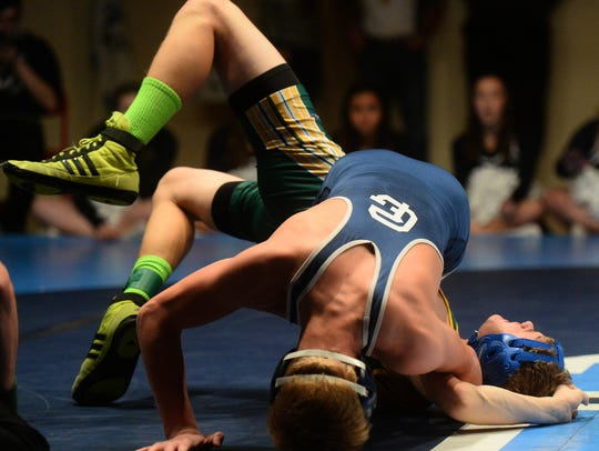 Great Falls High's Russell Wienholz attempts to pin