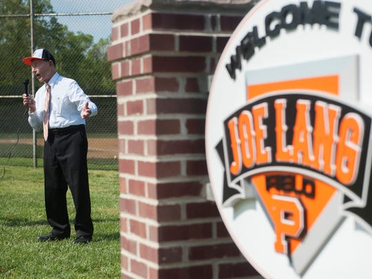 Former Pitman High School baseball coach Joe Lang speaks after members of the Pitman High School baseball team unveiled the new sign at their baseball field, which is dedicated to Lang.