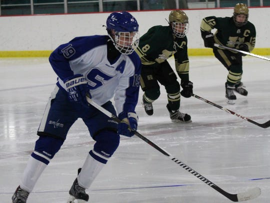 Carrying the puck up ice Saturday night is Salem senior