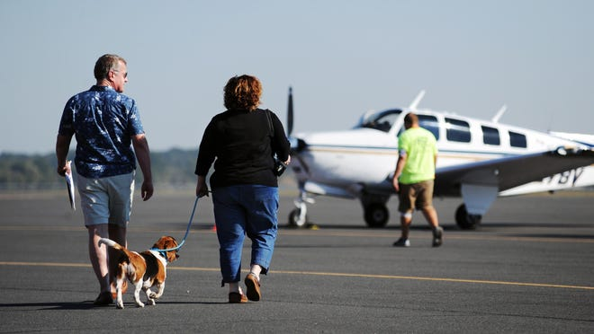 After picking up the Bassett Hound, Dixie, at Monroe Regional Airport, Jeff Wall and his puppy wrangler volunteer Amy Kittrell of Clinton head out for the second leg of the Pilots N Paws rescue mission. They head to Tuscaloosa, Alabama. Dixie had been with a family for eight years but were moving and couldn't take her with them. She will ultimately go to Tri-State Basset Hound Rescue in New York for placement in a home.