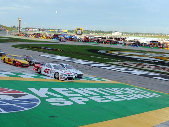 Kyle Larson (42) and Brad Keselowski (2) cross the