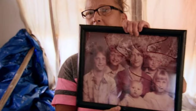 Kathy Neihart's family photo, which she said is the only one she has of her and her siblings, was restored as part of an effort to preserve memories lost during hurricane Harvey.