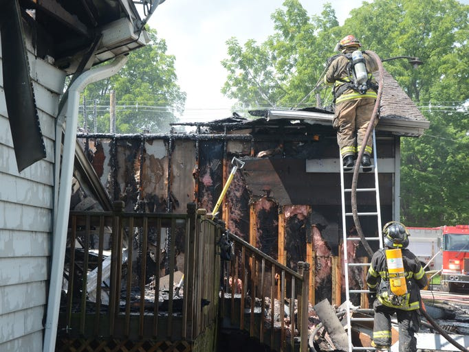 Firefighters look for any remaining smoldering debris