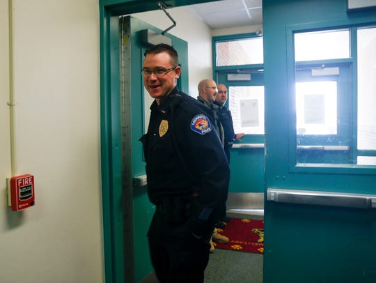 Members of the Farmington Police Department visit students and staff members at Mesa Verde Elementary School on Feb. 23 in Farmington.