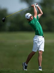 North's Eric Brinker drives off the 15th tee box during