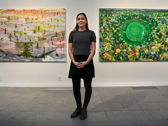 Sophia Heymans stands near two pieces from her current