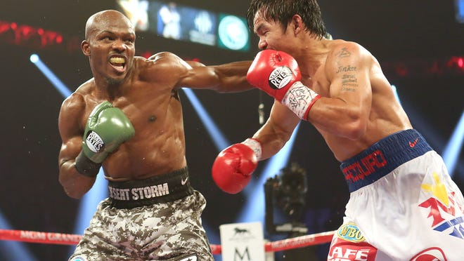 Timothy Bradley punches Manny Pacquiao during their rematch at the MGM Grand in Las Vegas on April 12. The fight will re-air on HBO on April 17.