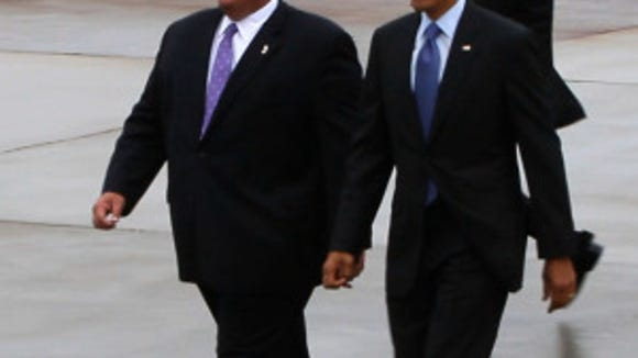 President Barack Obama and Gov. Chris Christie walk away from Air Force 1 at Joint Base McGuire-Dix-Lakehurst in May 2013. The president returns to New Jersey this afternoon for a speech at the base. (Bob Bielk/Asbury Park Press)