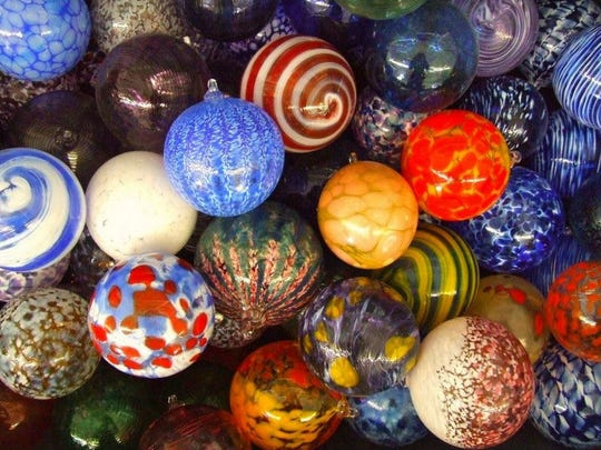 Louisville's Flame Run Gallery offers glass ornament