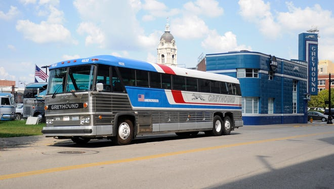 A 40 ft. long 1974 MC-8 Greyhound bus lines the block next to the old Greyhound bus station, now Bru Burger, in Downtown Evansville.