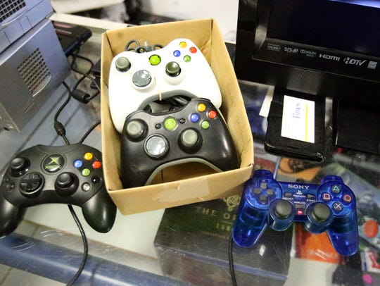 A variety of controllers at One More Level Retro Gaming