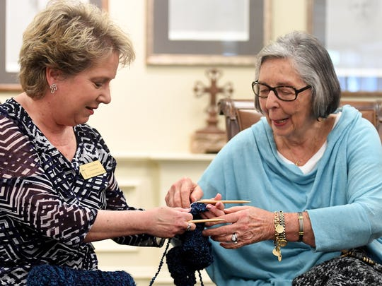 Lisa Harper receives help from Emily Bond during their pray shall ministry meeting, Wednesday, May 10.