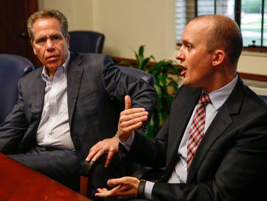 Butler University President Jim Danko, left, and Christian