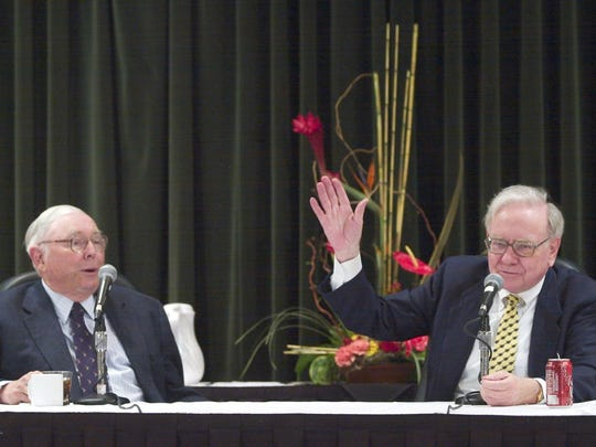Billionaire investor Warren Buffett, right, and his right-hand man Charlie Munger face journalists at a news conference in Omaha, Neb., Sunday, May 2, 2004, at the end of the weekend long annual Berkshire Hathaway shareholders meeting. (AP Photo/Nati Harnik)