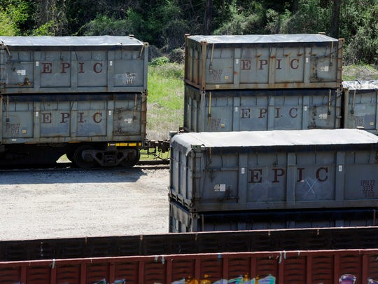 """This April 12, 2018 photo shows containers that were loaded with tons of sewage sludge in Parrish, Ala. More than two months after the so-called """"Poop Train"""" rolled in from New York City, Hall says her small town smells like rotting corpses. Some say the trainloads of New Yorkers' excrement is turning Alabama into a dumping ground for other states' waste."""